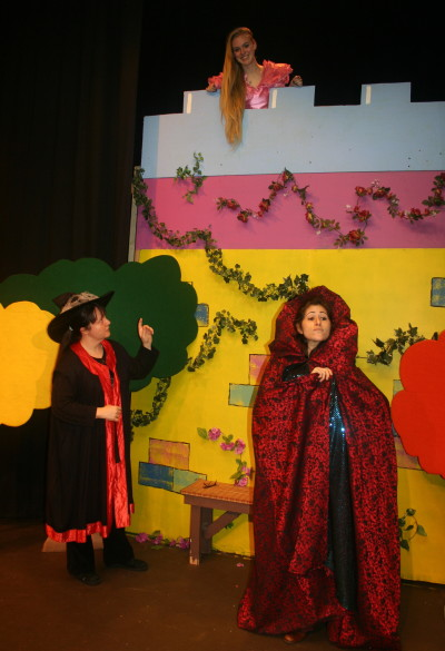 rapunzel in tower as teh witch and Evil Queen pay her a visit.