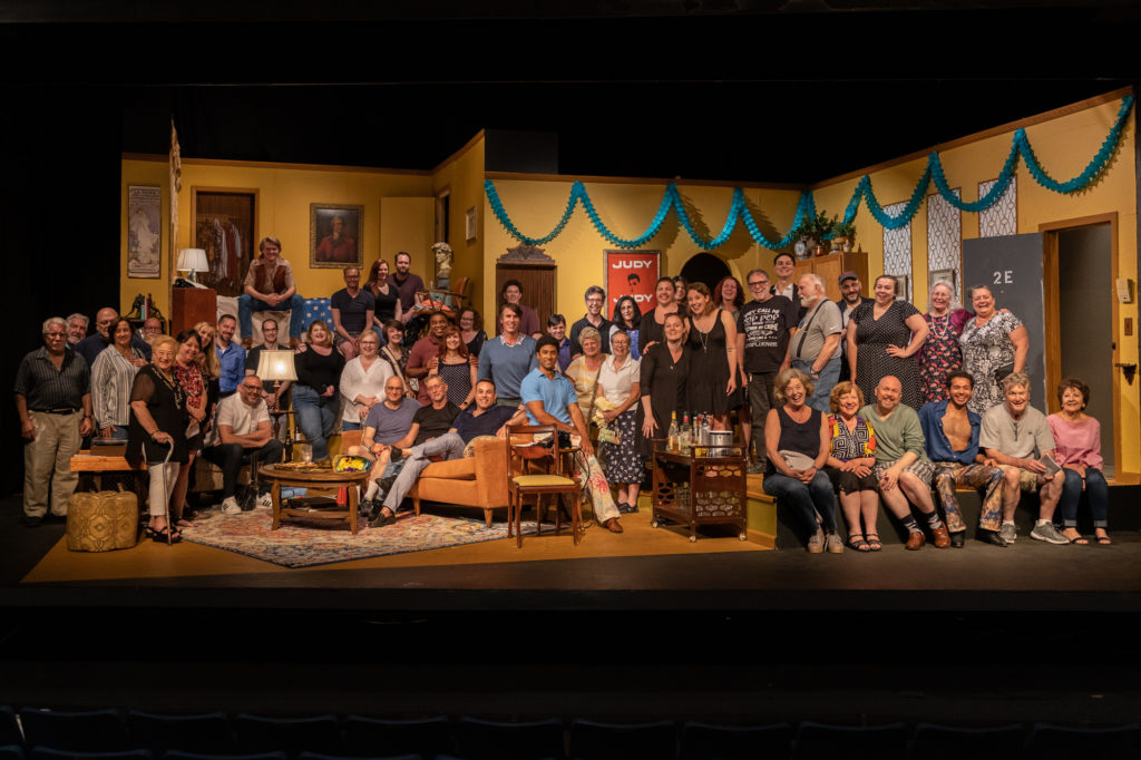 Audience invited on stage for a 50 years of Pride commemorative photo
